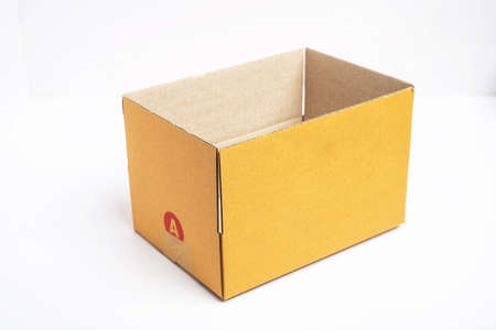Empty open and closed brown cardboard box isolated on white background with tape. Suitable for packaging. Stock Photo