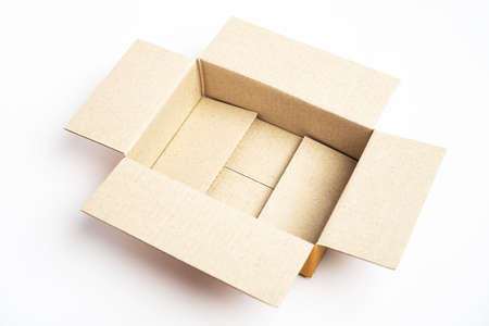 Open brown cardboard box on white background. Stock Photo