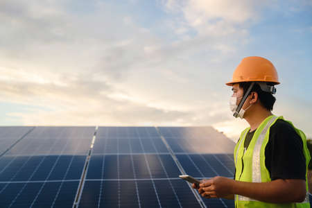Solar cell technician, The solar farm or solar panel with engineer working on checking and maintenance equipment at industry solar power, Photovoltaic module idea for clean energy production.