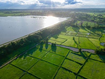 Aerial view of a picturesque reservoir. Near the pond, you can see a forest and agricultural fields. Spring time at Ban Rat Samakkhi in nongkhai, thailand.