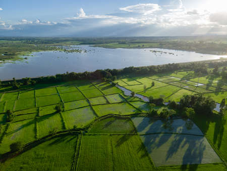 Aerial view of agricultural fields near the reservoir at Ban Rat Samakkhi in nongkhai, thailand. Stock Photo