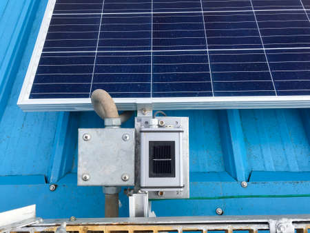 Equipment accessories of Solar power, Construction Solar panels or Solar cells on factory rooftop or terrace with sun light, Industry, Photo from smart phone