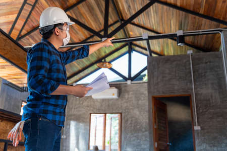 Construction engineer technician inspect the structure under the roof at construction site Stock Photo