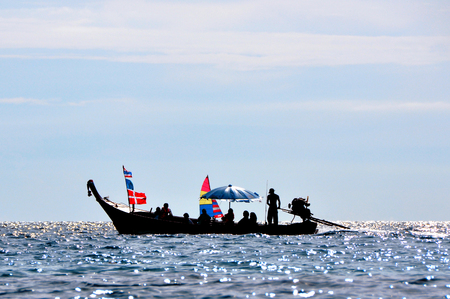 A small beautiful boat in the sea with people Stock Photo