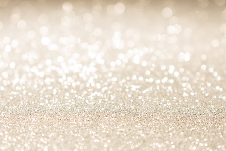 Christmas gold glitter vintage lights background. Holiday abstract texture.