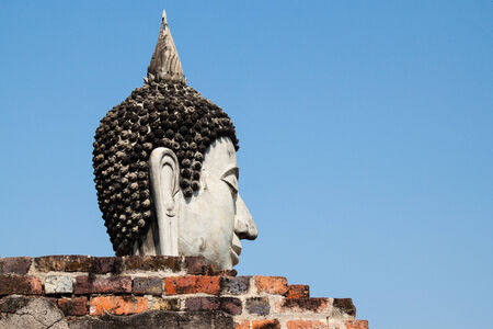 cambodia sculpture: Buddha face at historical site of Ayutthaya