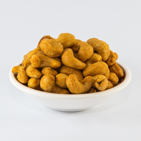 cashew tree: Cashew with salt in a white disk