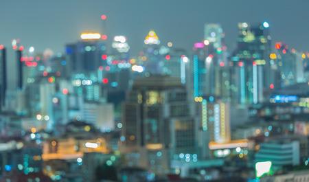 night city: Cityscape at twilight time, Blurred Photo bokeh Stock Photo