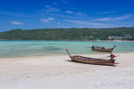 long tailed boat: Long tailed boat on beautiful sand beach of Thailand Stock Photo