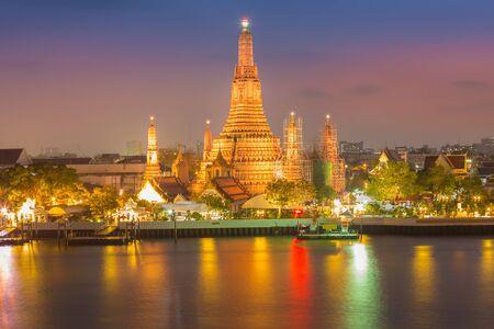 wat arun: After sunset at Wat Arun temple along with Bangkok river thailand