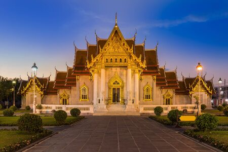 Marble Temple locate in central of Bangkok Thailand, after sunset photo