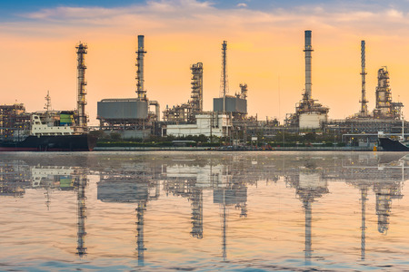 Petrochemical plant at sunrise with water relfection