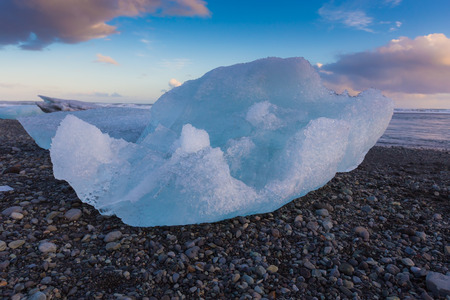 icefjord: Ice cube on black volcano rock beach, Iceland