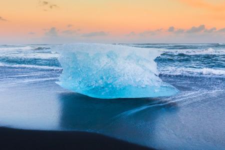 icefjord: Ice cube on black volcano sand beach, Iceland