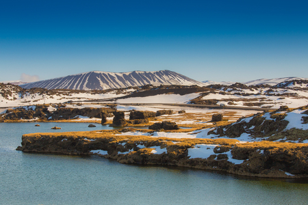 Valcano mount and lake in Myvatn Winter landscape, Iceland photo