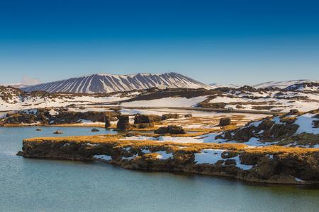 Valcano mount and lake in Myvatn Winter landscape, Iceland photo