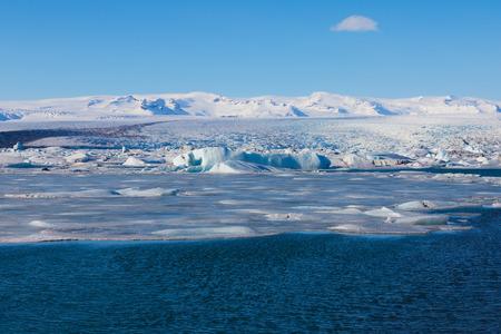 calving: Jokulsarlon, blue ice lagoon. Iceland