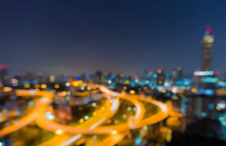 Twilight of Bangkok highway with defocused bokeh lights as abstract background photo