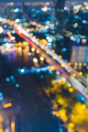 city panorama: Blurred lights of bridge across river in Bangkok Thailand