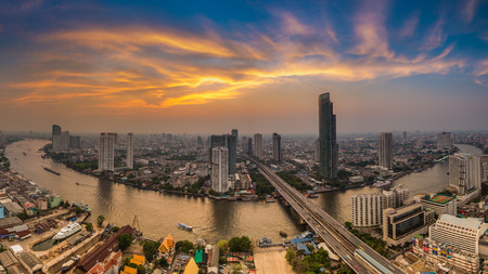 Beautiful of Bangkok aerial view city with Chao Phraya river curve during sunset, Long exposure effect Stock Photo