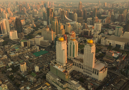 Modern building in the business landscape. Bird eyes view of Bangkok during sunset