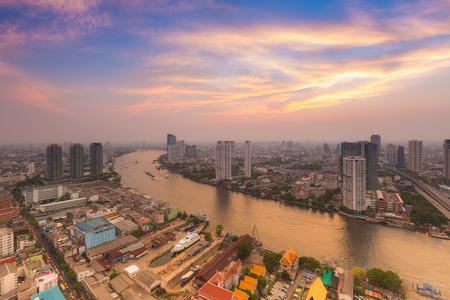 Skyline of Chao Phraya river curve after sunset, Bangkok photo