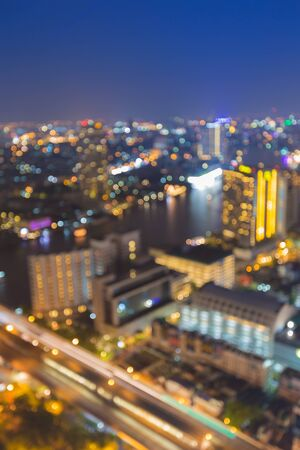 main river: Aerial view of bokeh light skyline Bangkok city with main river curve Stock Photo