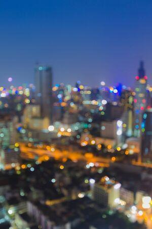 Abstract urban night light bokeh  defocused background at night photo