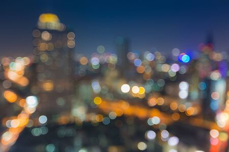 Blurred abstract background with bokeh of Bangkok cityscape at night photo