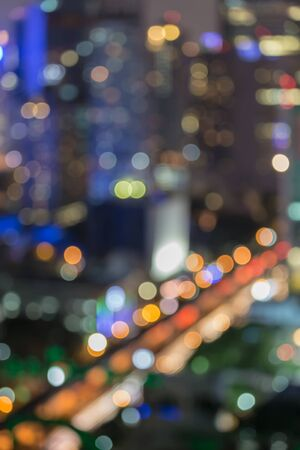 Abstract blur bokeh city road at night with office building background photo
