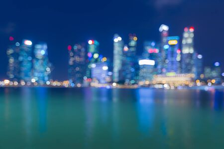 city light: Abstract blurred bokeh city light view with water reflection Stock Photo