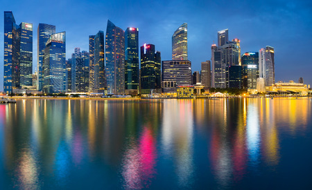 southeast asia: Beautiful Office building twilight with water reflection Singapore Stock Photo