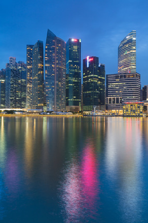 fiance: Singapore main business fiance office with water reflection during twilight Stock Photo