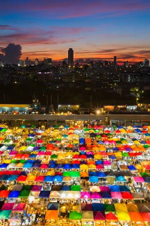 Multiple colour of umbrella free market during sunset Thailand Standard-Bild