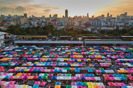 multi colour: City weekend market aerial view with multi colour umbrella during sunset Stock Photo