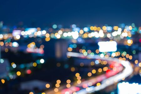 city road: Twilight city road curve abstract blur bokeh background Stock Photo