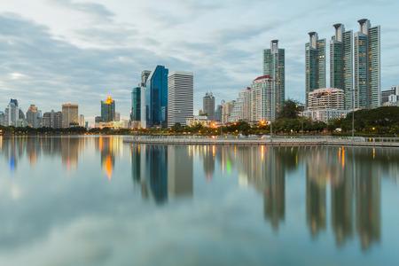 benjakitti: Bangkok city downtown twilight with water reflection of skyline Benjakitti ParkBangkokThailand Stock Photo