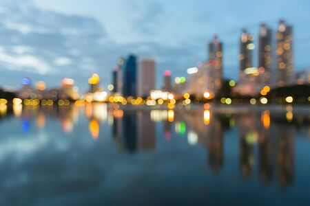Abstract city bokeh lights during blue hours, with water reflection