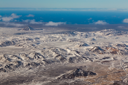 sunshines: Aerial view of snowy mountains and agriculture during winter out of  the plan, Iceland Stock Photo