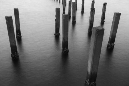 sandbank: Black and White of Fence protect sandbank from sea wave, nature protection Stock Photo