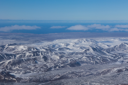 showy: Aerial view of showy mountains during winter, Iceland