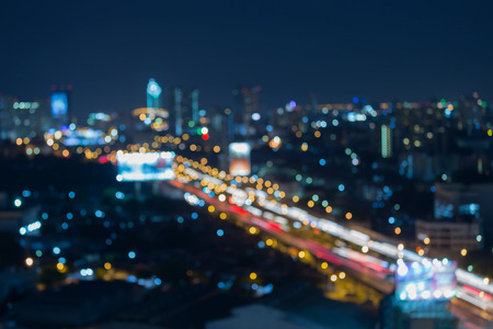 city lights: Abstract blurred bokeh lights of city road at night