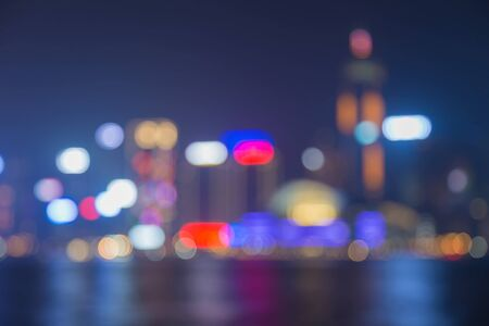 abstract building: Blurred bokeh lights of Hong Kong city at night with water reflection Stock Photo