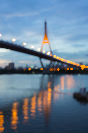 reflection water: Abstract blurred bokeh light, suspension bridge with water reflection