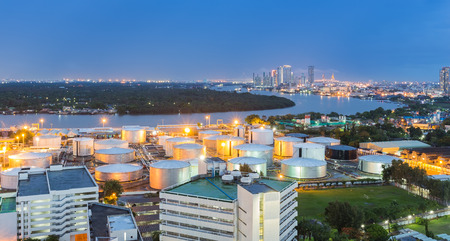 storage tank: Oil storage tank along with river at night with city background Stock Photo