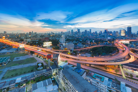 nightfall: Elevated road junction and interchange with City background