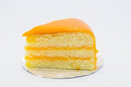 orange cake: Soft homemade Orange cake on white background Stock Photo