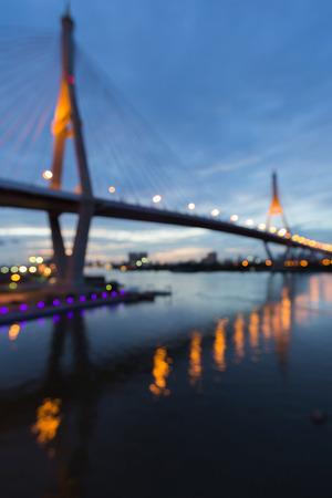 bridged: Suspension bridged, Blurred bokeh background with water reflection