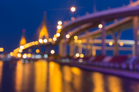 bridged: Suspension bridged and highway curved, Blurred bokeh background with water reflection