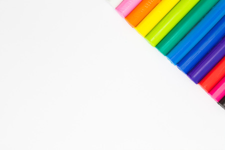 conner: Rainbow colour modelling clay sticks on conner of white background